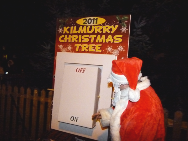 Santa Turns On The Christmas Lights..
