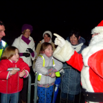 Santa Claus Switching on Christmas Lights.